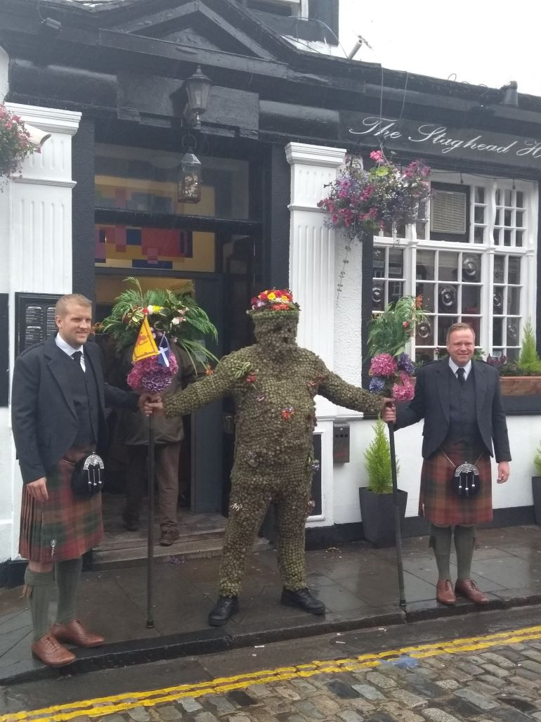 The Burryman leaving the Stag Head Hotel in 2019