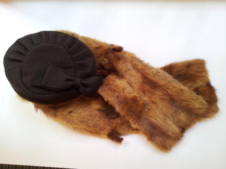 Fur stole and dark brown fabric hat with large bow