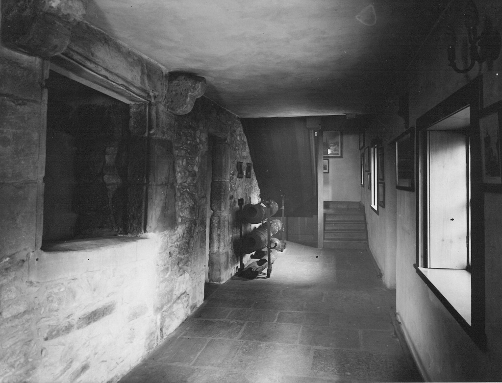 A view of the ground floor of Huntly House Museum in the 1930s. The elm wooden water pipes seen here are now in the first floor gallery. © The City of Edinburgh Council Museums & Galleries