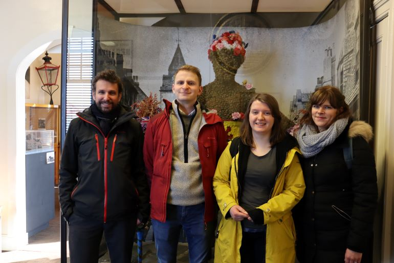 Some of the Auld Reekie Retold team - Nico, Oliver, Suzy and Gabriella – meeting the Burryman in Queensferry Museum, early 2020