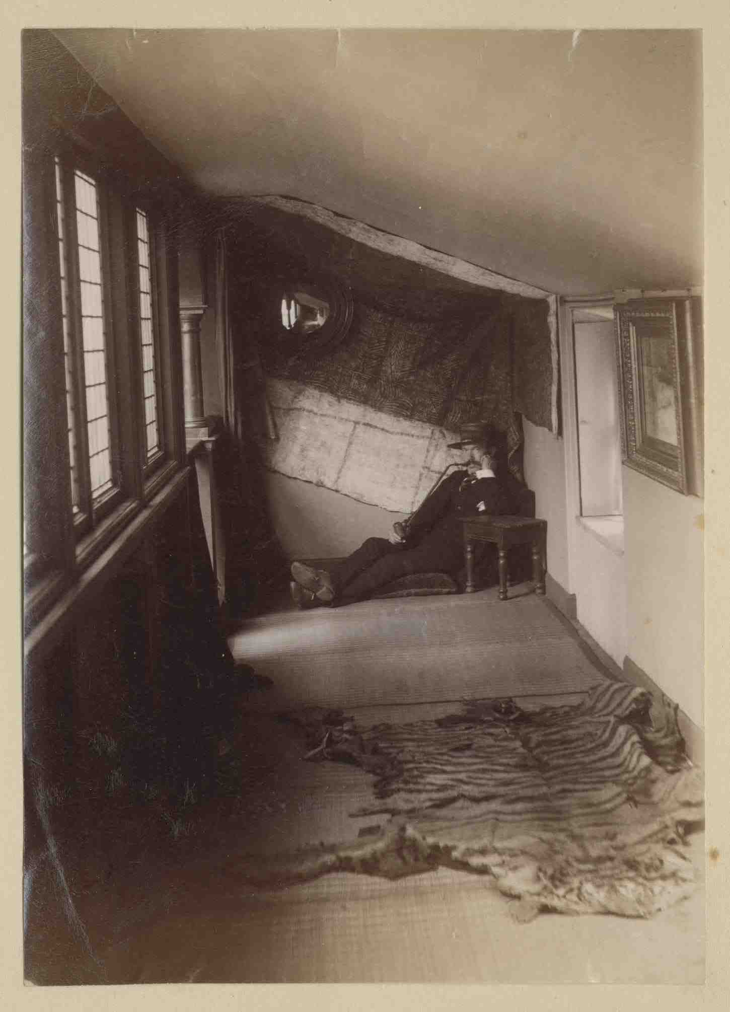 Lauriston photograph album – artist's studio with man  seated in the corner of an attic