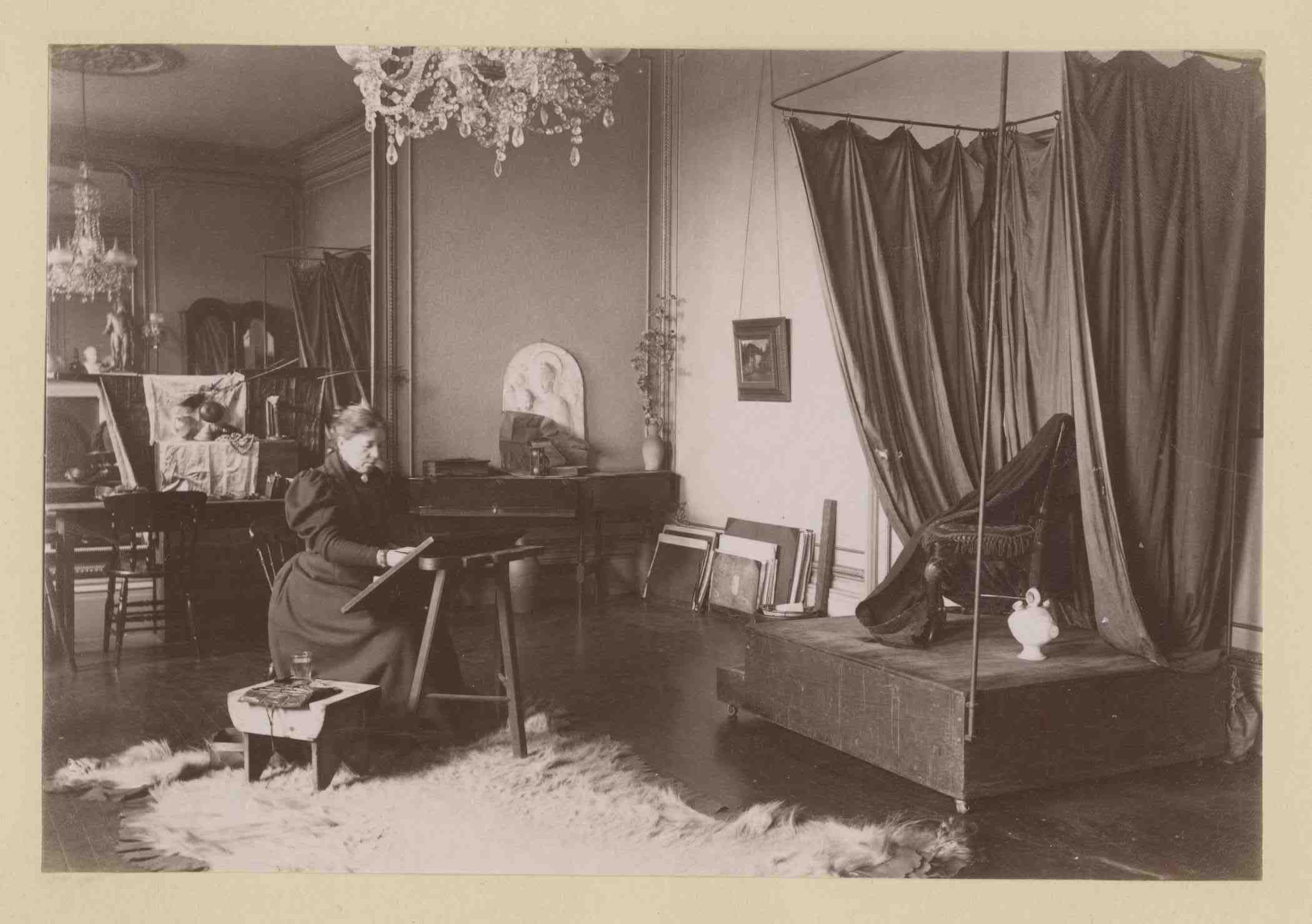 Lauriston photograph album – artist's studio with man reclining on a travelling couch