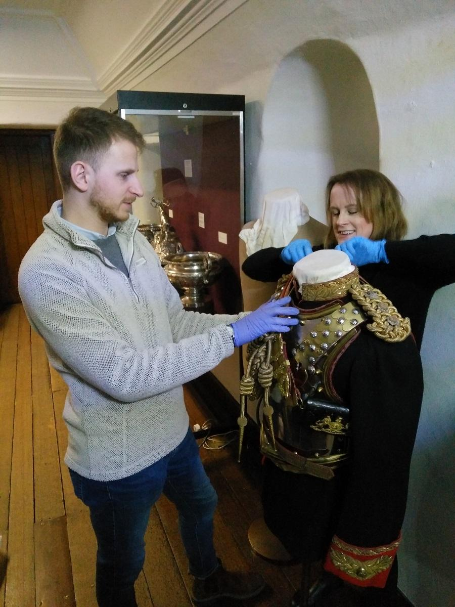 Vicky and Collections Assistant Oliver Taylor installing a mannequin showing Field Marshal Earl Haig's dress uniform as Colonel of the Royal Horse Guards at the Museum of Edinburgh © City of Edinburgh Council Museums & Galleries; Museum of Edinburgh