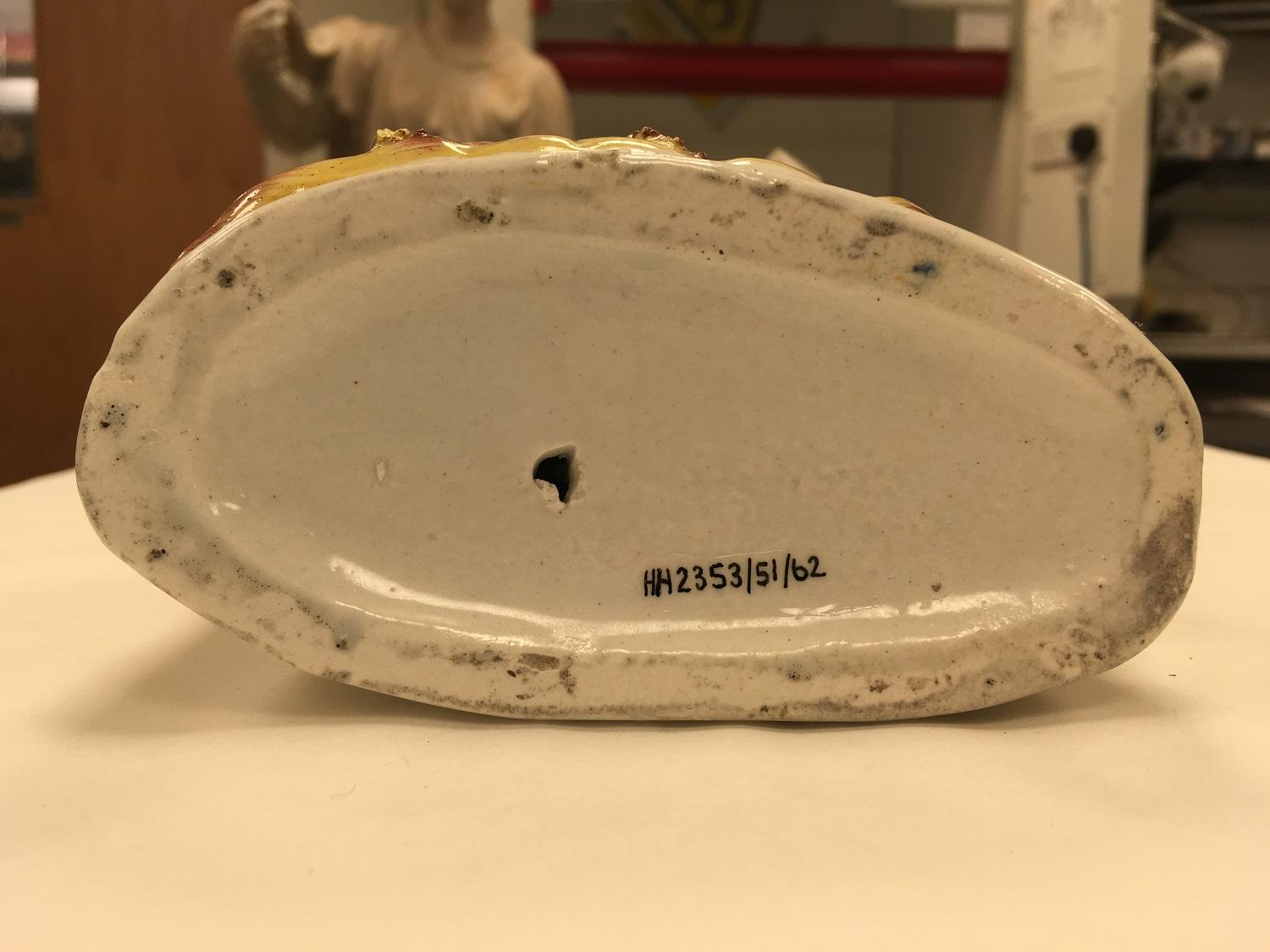 Number in ink on ceramic object