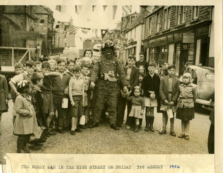 The Burryman surrounded by children, 1956