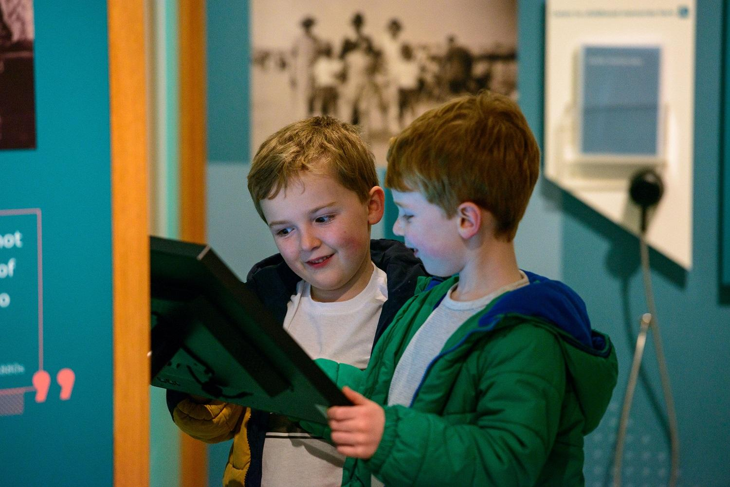 Two children enjoy the exhibition. Photo by Ian Georgeson