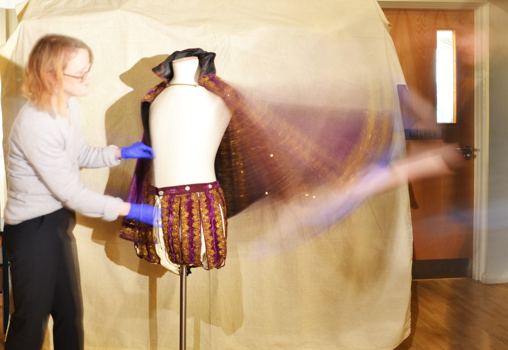 So swishy! A slow exposure of Victoria Garrington (History Curator, M&GE) and I mounting the outfit. © City of Edinburgh Council Museums & Galleries; Museum of Edinburgh