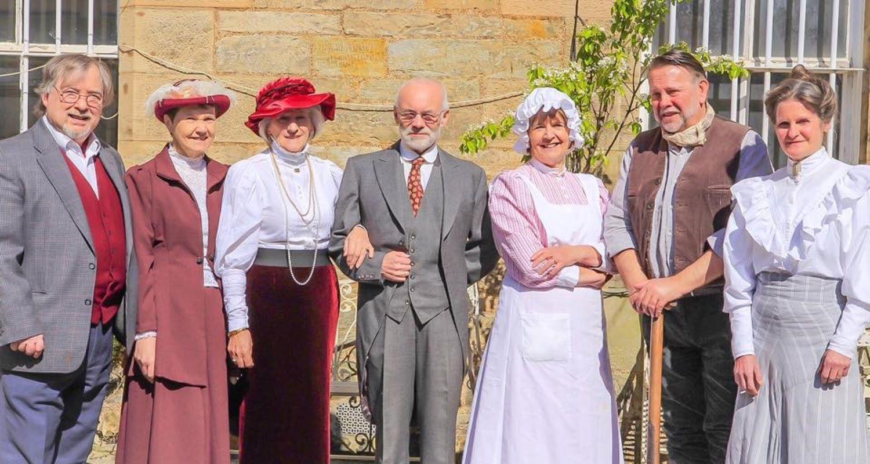 7 members of the Edinburgh Living History group dressed in Edwardian dress