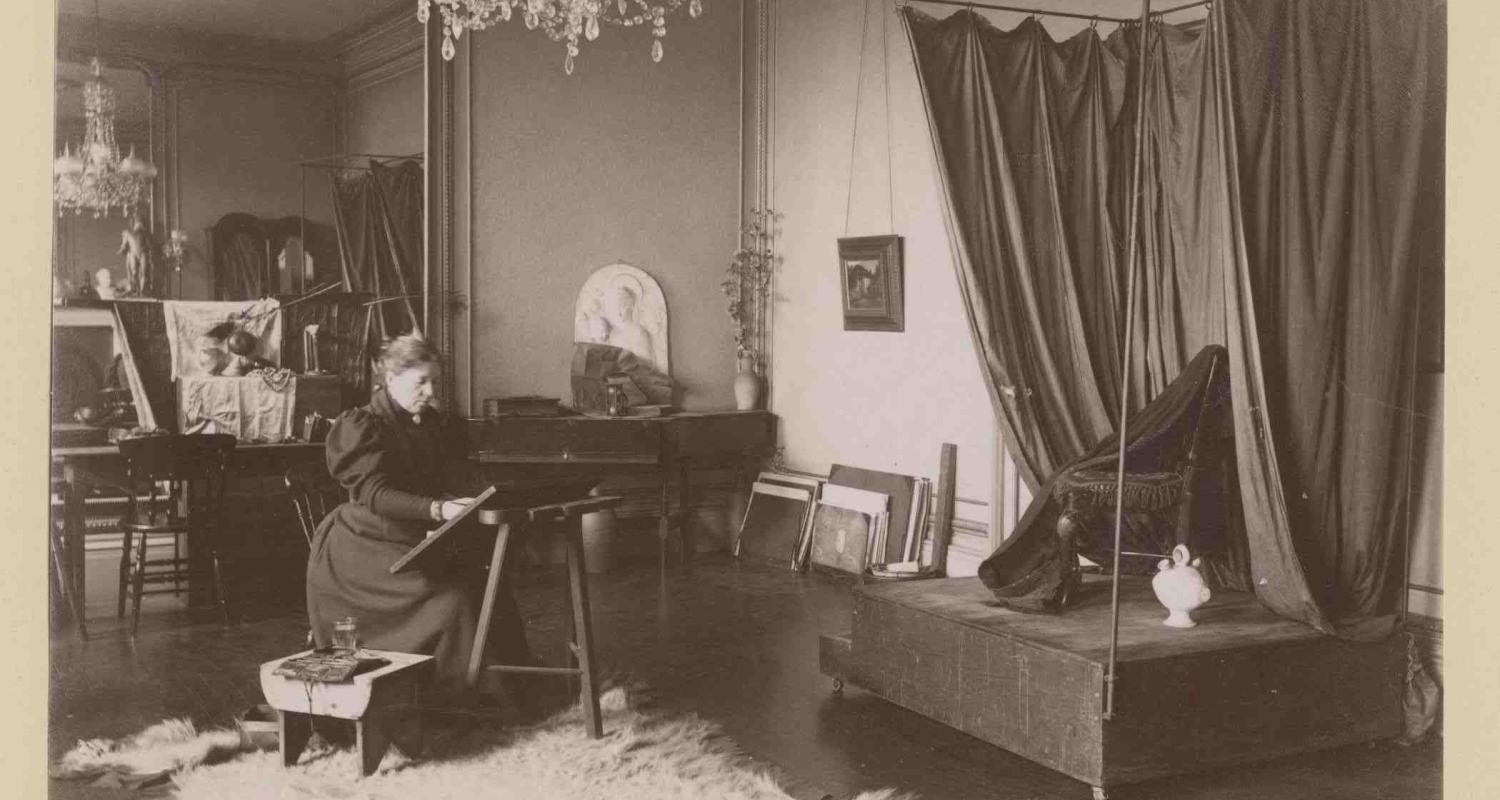 Lauriston photograph album – artist's studio with woman seated at an easel