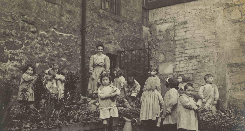Lileen Hardy & children gardening at St Saviour's Child Garden