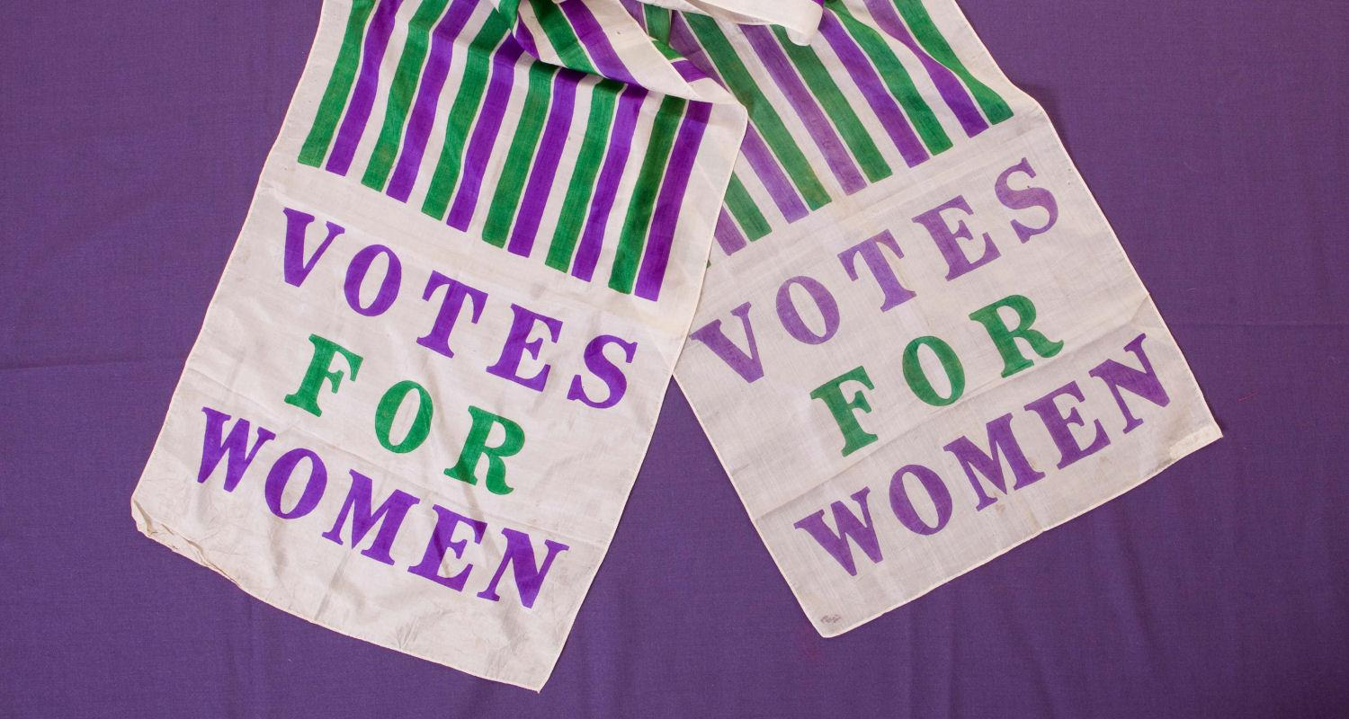 Votes for Women sash in the colours of the  Women's Social Political Union