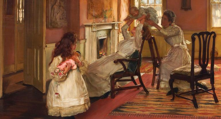 Edwardian family in a room, mother and maid playing with baby, little girl looks on with her doll.