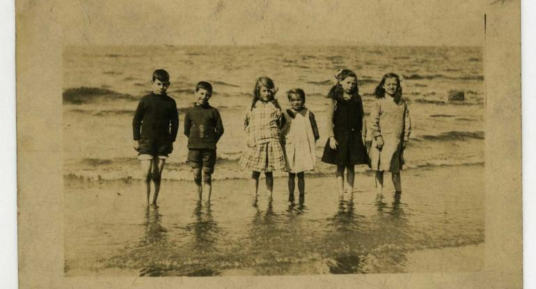 Jean Crawford and a group of friends paddle at the beach