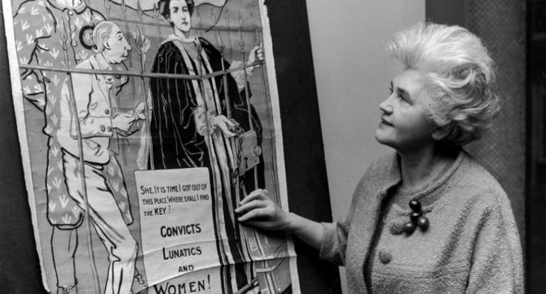 Woman looking at poster