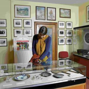 A visitor enjoys the displays at The Writers' Museum. Image (c) Museums & Galleries Edinburgh