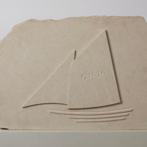 Stone carving with sail boat by artist Ian Hamilton Finlay