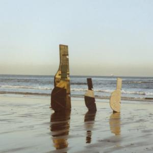 Robert Callender, works including 'Stray Fifie Rudder', 1984 and 'Cracked Rudder', 1984, on the beach at Kinghorn, 1990s. Courtesy of the estate of Robert Callender. Photography Robert Callender
