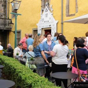 A group of volunteers chatting in the courtyard at the Museum of Edinburgh